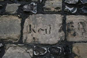 Carved lettering on a stone