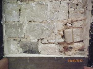 Exposed stonework in chimney on 1st floor