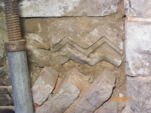 Jig-zag moulding on Caen stone found behing sacrificial Tudor brick panel at back of fireplace