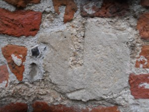 Reused Quarr stone in W facing wall of house