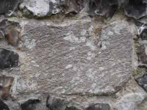Reused Quarr stone in end chimney