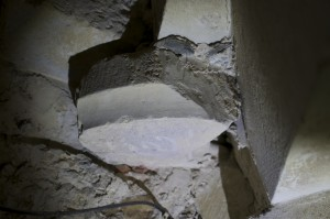 Capital base (inverted) reused in spiral stairs