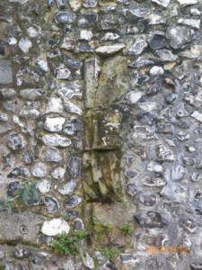 Vertical line ofmoulded stone to left of Almoner's Hall window, probably the edge of a doorway before being blocked up