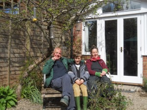 Householders Chrissie and Martin Leyden with grandsn Joe looking very relaxed at the start of Day 2
