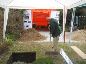Supervisor Don Bryan claening up round one of the trenches at a quiet period Sunday afternoon - the dejection is apparent