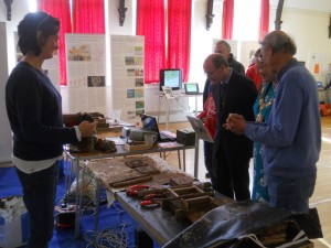 Kate Arnold explaining to the mayor, Jane Rutter, and her escort, Duncan, the tile making process