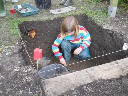 A junior digger working on Trench 2 of the 2016 excavations
