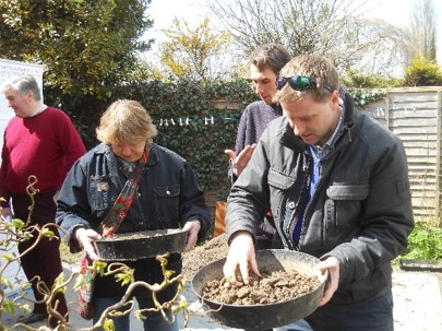 Hyde900 trustee Rose Burns and local MP Steve Brine sieve for small finds  at the 2016 dig with dig advisor David Ashby looking on