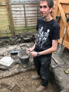 David Ashby, University of Winchester and Advisor to the 2017 Hyde900 Community Dig, in Trench 7 with abacus