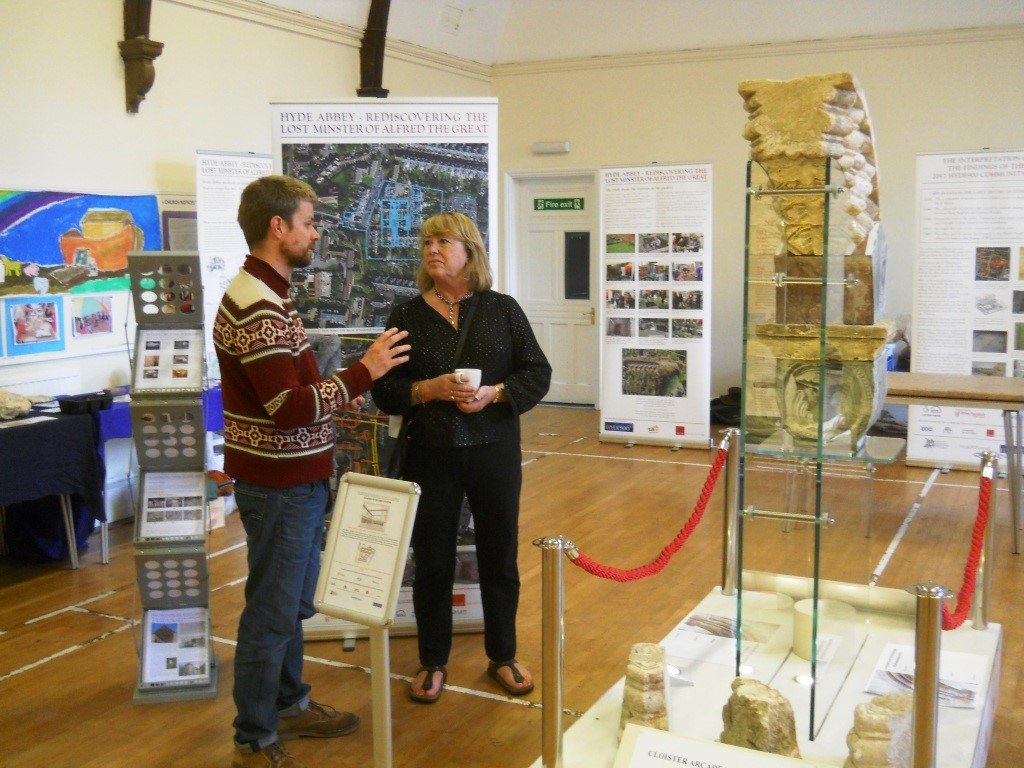 Hyde900 trustee Rose Burns discusses the display with Ross Lovett until recently head mason at Winchester Cathedral